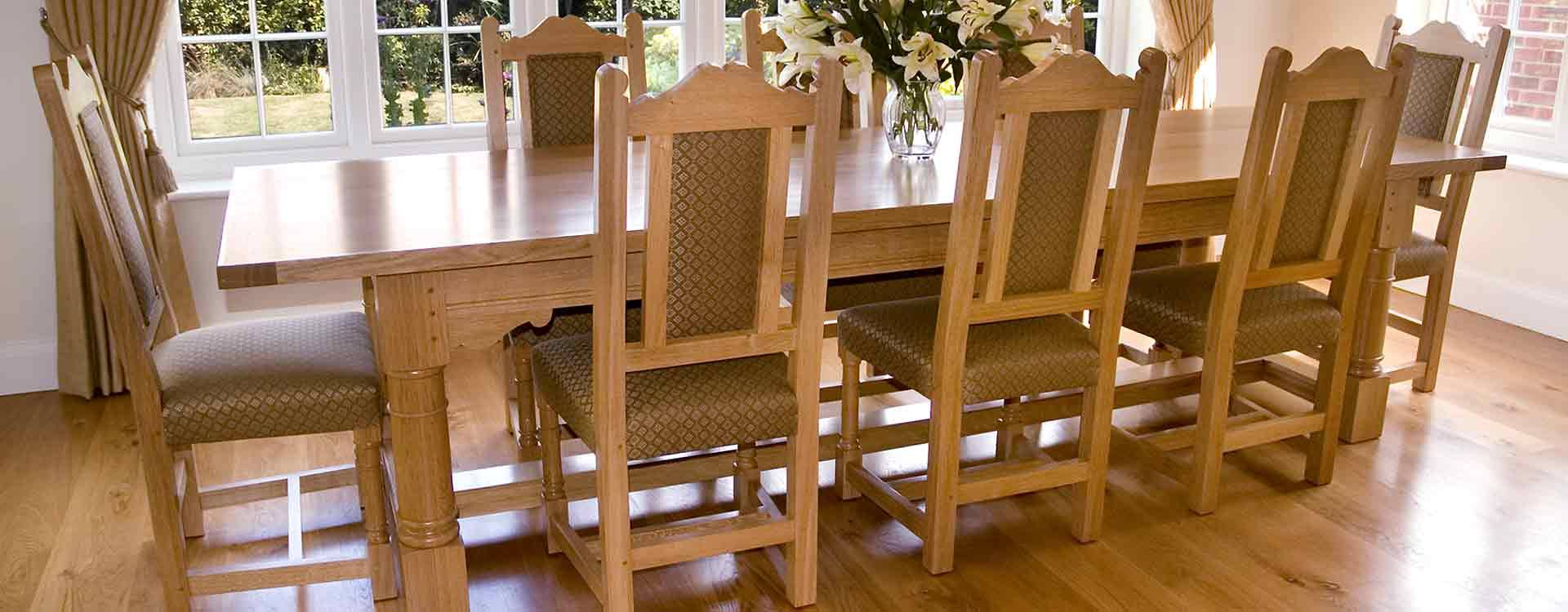 solid oak refectory table and matching dining chairs